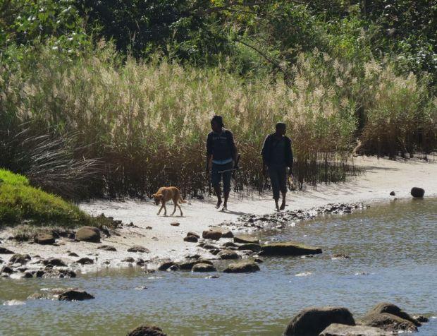 r fishermen with dog
