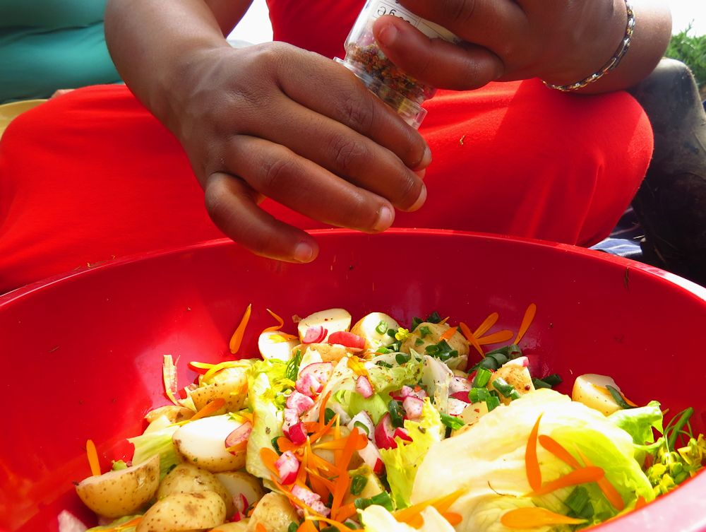 r grinding pepper onto potato salad 1